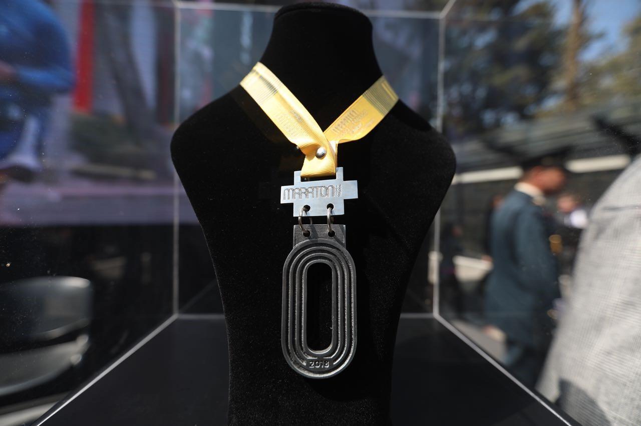 medalla letra O del maraton de la ciudad de mexico 2018